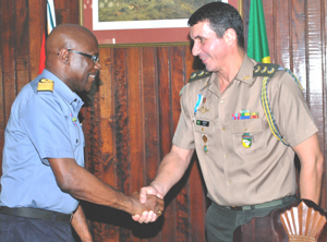 Commodore Gary Best congratulates Colonel Eudes Carvallho Dos Santos after he was awarded the Military Efficiency Medal (MEM).